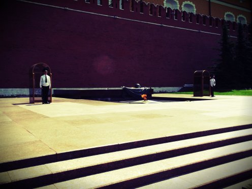 Guards stand against the red wall of the Kremlin