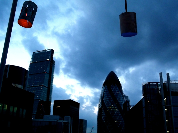 Colourful lamps over a brooding London skyline at the Skylounge rooftop bar